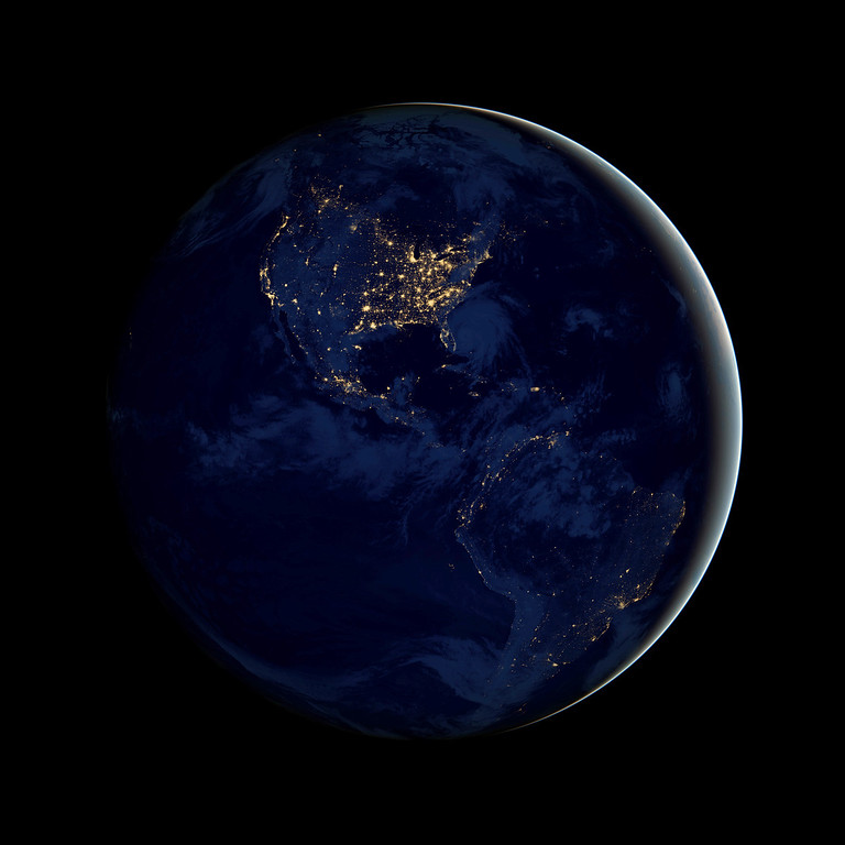 Description of . This image obtained from NASA shows a new global view Earth's city lights which is a composite assembled from data acquired by the Suomi NPP satellite. The data was acquired over nine days in April 2012 and 13 days in October 2012. It took 312 orbits to get a clear shot of every parcel of Earth's land surface and islands. This new data was then mapped over existing Blue Marble imagery of Earth to provide a realistic view of the planet. AFP PHOTO / NASA