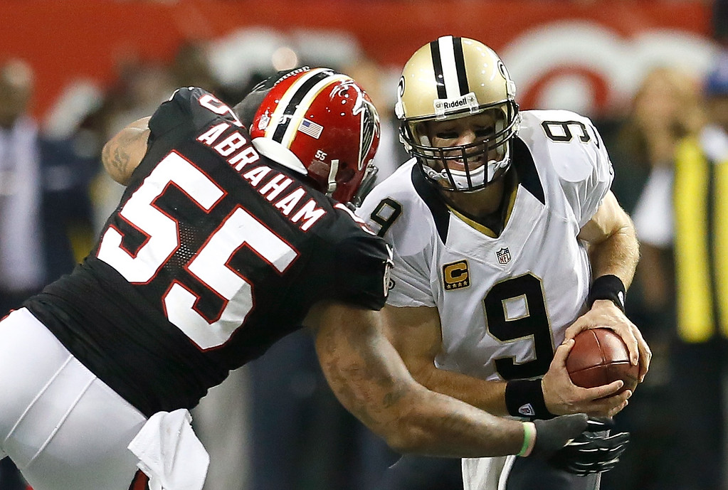 Description of . ATLANTA, GA - NOVEMBER 29:  John Abraham #55 of the Atlanta Falcons sacks Drew Brees #9 of the New Orleans Saints at Georgia Dome on November 29, 2012 in Atlanta, Georgia.  (Photo by Kevin C. Cox/Getty Images)