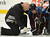 DENVER, CO. - FEBRUARY 11: Colorado Avalanche trainer Matt Sokolowski tends to Cody McLeod (55) of the Colorado Avalanche as he's slow to get up from the ice during the third period February 11, 2013 at Pepsi Center. The Phoenix Coyotes defeated the Colorado Avalanche 3-2 on a Shane Doan (19) shot to beat Semyon Varlamov with 1:00 min left in overtime. (Photo By John Leyba/The Denver Post)