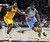 Denver Nuggets Kenneth Faried (R) dribbles down the lane past Cleveland Cavaliers defender Tristan Thompson (L) during the first quarter of their NBA basketball game in Cleveland, February 9, 2013.REUTERS/Aaron Josefczyk