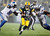 Green Bay Packers quarterback Aaron Rodgers (12) tries to run between Detroit Lions' Nick Fairley (98) and DeAndre Levy (54) during the first half of an NFL football game Sunday, Dec. 9, 2012, in Green Bay, Wis. (AP Photo/Mike Roemer)