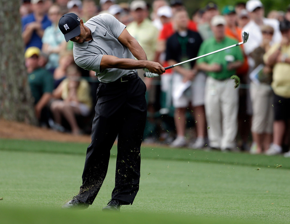 Description of . Tiger Woods hits on the first fairway during the first round of the Masters golf tournament Thursday, April 11, 2013, in Augusta, Ga. (AP Photo/Darron Cummings)