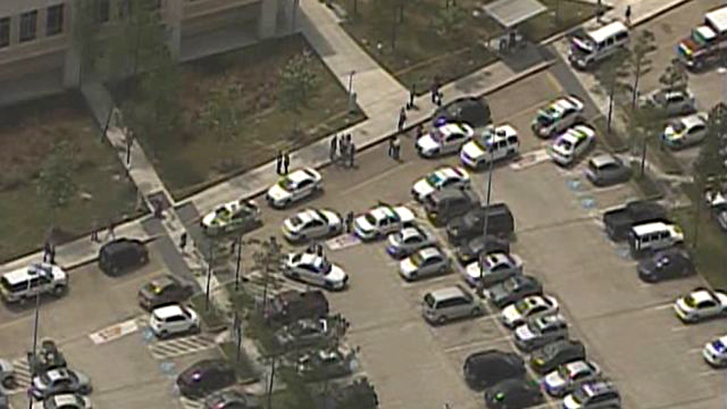 Description of . Law enforcement personnel gather near the scene of a mass stabbing at the Cy-Fair campus of Lone Star College in northwest Houston, as seen in this still image from video courtesy of KPRC-TV April 9, 2013. REUTERS/KPRC-TV
