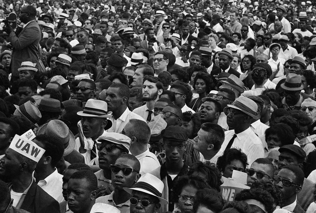 Description of . A crowd gathers at the Lincoln Memorial in Washington, Aug. 28, 1963 to hear speakers in ceremonies following the March on Washington parade through the Capitol streets. (AP Photo)
