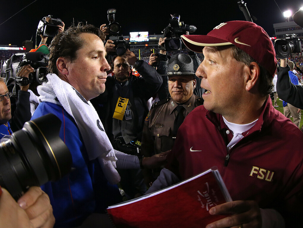 Description of . Florida Gators head coach Will Muschamp shakes hands with Florida State Seminoles head coach Jimbo Fisher following a game  at Doak Campbell Stadium on November 24, 2012 in Tallahassee, Florida.  (Photo by Mike Ehrmann/Getty Images)