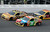 Kyle Busch (18) races with Austin Dillon (33) and Jeff Burton (31) during the second of two 150-mile qualifying race for Sunday's NASCAR Daytona 500 auto race, Thursday, Feb. 21, 2013, at Daytona International Speedway in Daytona Beach, Fla. Busch won the race. (AP Photo/Chris O'Meara)
