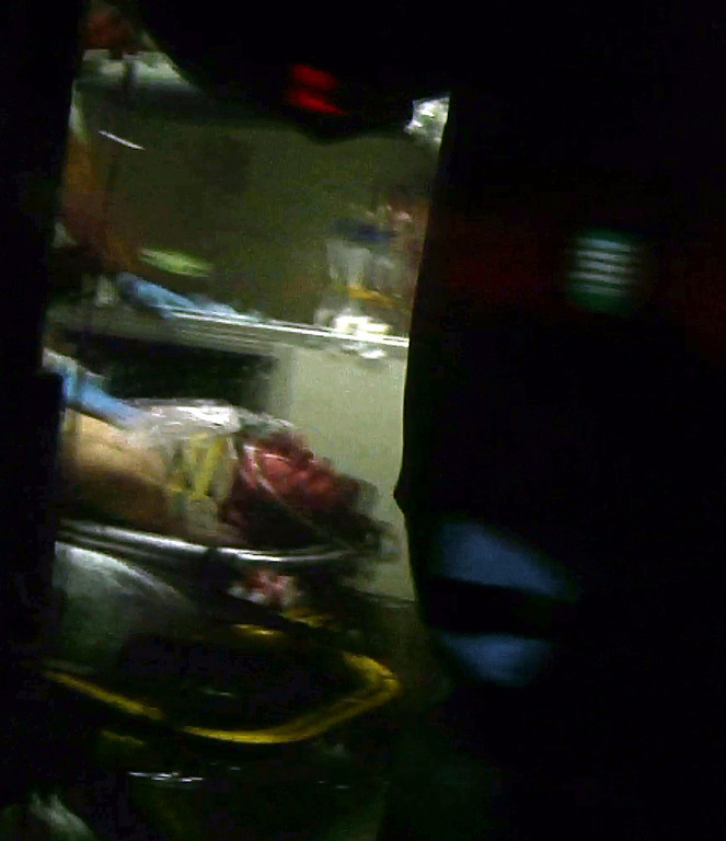 Description of . This still frame from video shows Boston Marathon bombing suspect Dzhokhar Tsarnaev visible through an ambulance after he was captured in Watertown, Mass., Friday, April 19, 2013. A 19-year-old college student wanted in the Boston Marathon bombings was taken into custody Friday evening after a manhunt that left the city virtually paralyzed and his older brother and accomplice dead.  (AP Photo/Robert Ray)