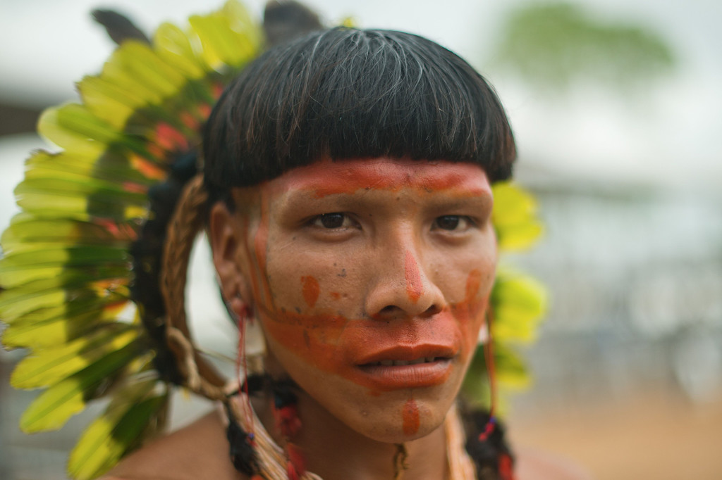 Description of . A Brazilian indigenous man of teh Enawenen Awe tribe poses during the XII International Games of Indigenous Peoples in Cuiaba, Mato Grosso state, Brazil on November 12, 2013. 1500 natives from 49 Brazilian ethnic groups and from another 17 countries are gathering in Cuiaba until November 16 to compete in some 30 athletic disciplines, many of their own. AFP PHOTO / Christophe SIMON/AFP/Getty Images