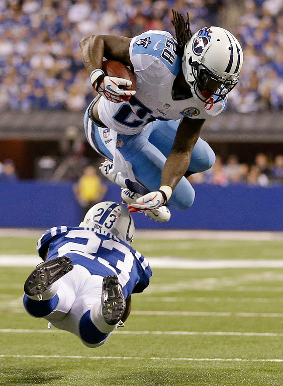Description of . Tennessee Titans' Chris Johnson (28) is tackled by Indianapolis Colts' Vontae Davis (23) during the second half of an NFL football game, Sunday, Dec. 9, 2012, in Indianapolis. (AP Photo/Jeff Roberson)