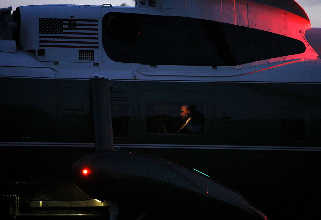 . U.S. President Barack Obama sits aboard Marine One as it lands on the South Lawn of the White House October 23, 2012 in Washington, DC. Obama was returning from campaign events in Florida and Ohio following last night\'s third and final final presidential debate.  (Photo by Alex Wong/Getty Images)