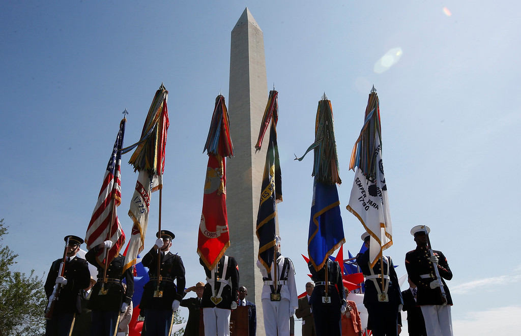 . The Armed Forces Color Guard presents the colors at the Washington Monument in Washington, Monday, May 12, 2014, during a ceremony to celebrate its re-opening.  (AP Photo)