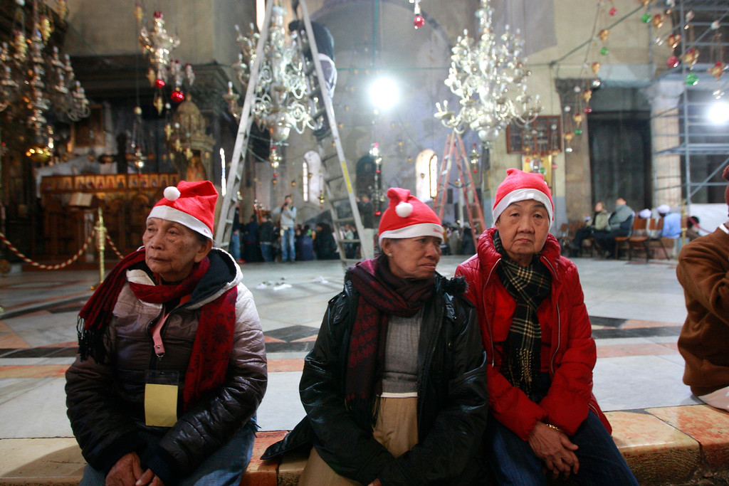Description of . Christian worshippers visit the Church of Nativity, traditionally believed by Christians to be the birthplace of Jesus Christ, in the West Bank town of Bethlehem on Christmas Eve, Tuesday, Dec. 24, 2013. (AP Photo/Majdi Mohammed)