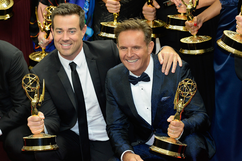 Description of . Producer Carson Daly (L) and Executive Producer Mark Burnett, winners of the Outstanding Reality - Competition Program Award for 'The Voice,' pose in the press room during the 65th Annual Primetime Emmy Awards held at Nokia Theatre L.A. Live on September 22, 2013 in Los Angeles, California.  (Photo by Kevork Djansezian/Getty Images)