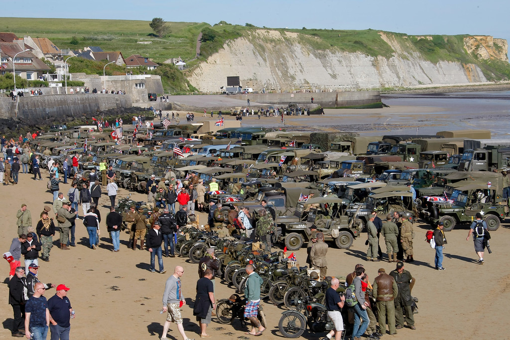 Description of . World War II military vehicles are displayed on the beach of Arromanches, France, Friday, June 6, 2014, as part of D-Day commemorations. World leaders and veterans gathered by the beaches of Normandy, northern France, on Friday to mark the 70th anniversary of the World War II D-Day landings. (AP Photo/Claude Paris)