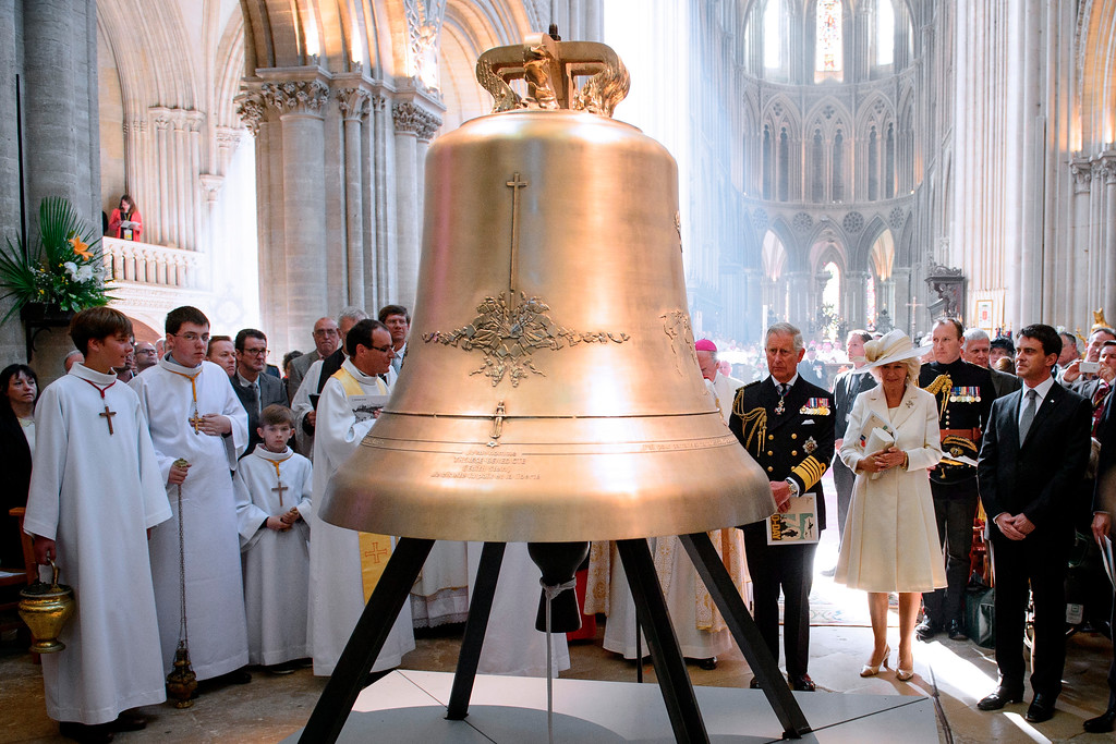 Description of . Britain's Prince Charles, center and his wife Camilla, the Duchess of Cornwall, attend a bell-naming ceremony during a British D-Day commemoration ceremony in Bayeux Cathedral, northern France, Friday, June 6, 2014. World leaders and veterans gathered by the beaches of Normandy on Friday to mark the 70th anniversary of World War Two's D-Day landings. (AP Photo/Leon Neal, Pool