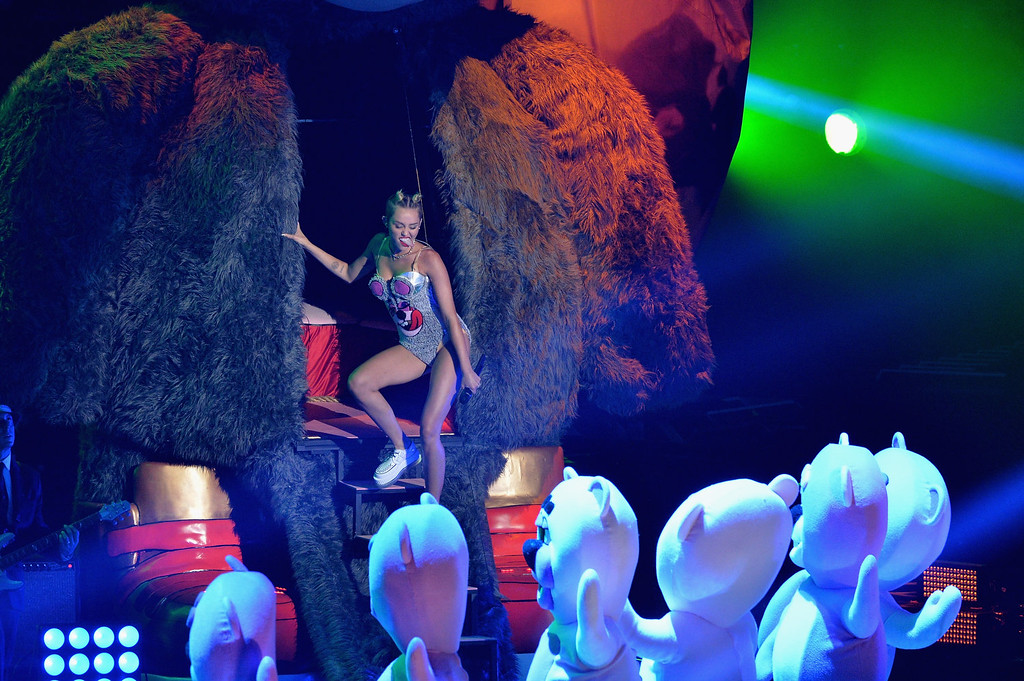 Description of . Miley Cyrus performs onstage during the 2013 MTV Video Music Awards at the Barclays Center on August 25, 2013 in the Brooklyn borough of New York City.  (Photo by Rick Diamond/Getty Images for MTV)