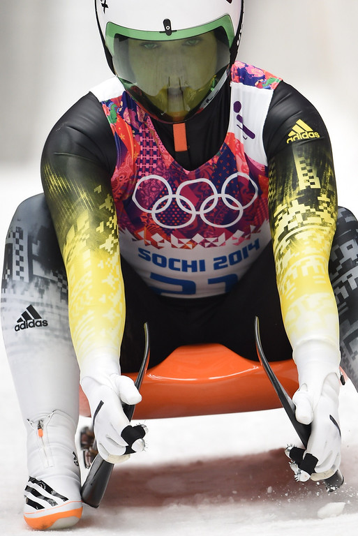 Description of . Latvia\'s Eliza Tiruma brakes at the end of her run 3 in the Women\'s Luge Singles event of the Sochi Winter Olympics on February 11, 2014 at the Sanki Sliding Center.   LEON NEAL/AFP/Getty Images