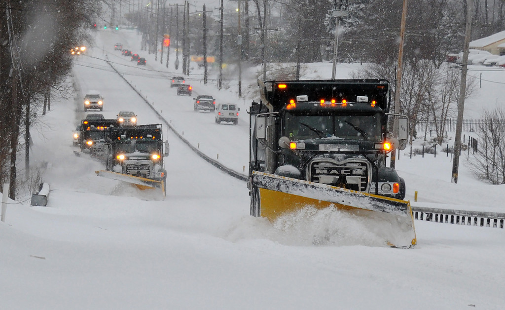Description of . A plow train heads south on Route 202 between Dilworthtown Road and Route 1 in Birmingham Township on Thursday, Feb. 13, 2014.  The latest storm  during a relentless and frigid winter spread heavy snow and sleet over the mid-Atlantic and the Northeast on Thursday.  (AP Photo/Philadelphia Inquirer, Clem Murray)