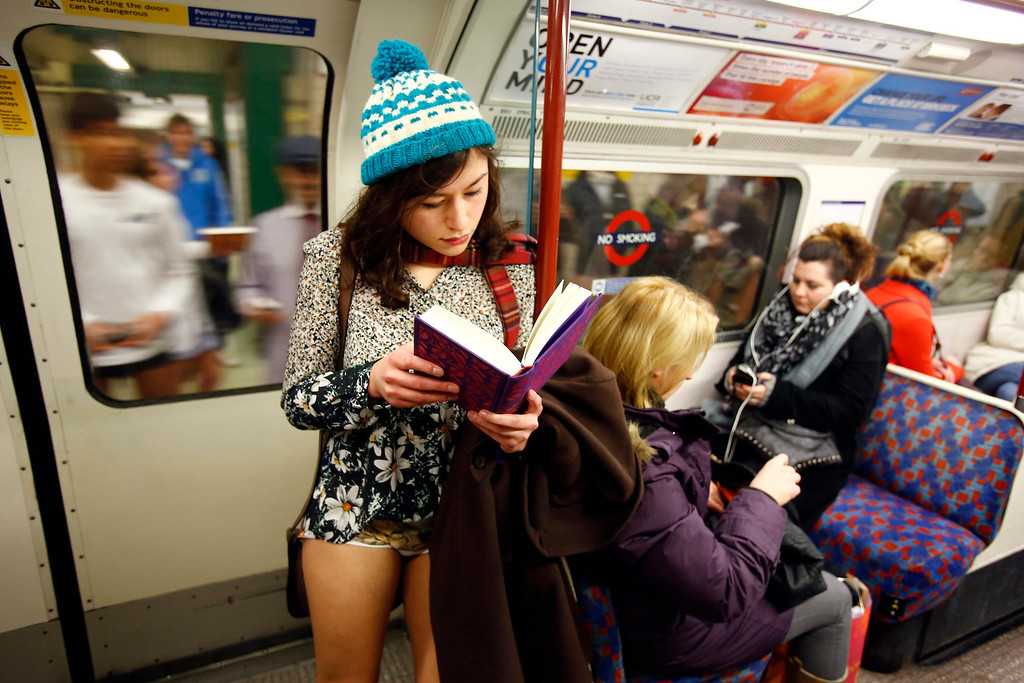 Description of . A woman takes part in a No Pants Day 2014 flash mob on the London Underground, in London, Britain, 12 January 2014. The event is organized by Improv Everywhere and takes place in many cities across the world. The goal for the participants is to get on public transport dressed in normal winter clothes, but without pants while keeping a straight face.  EPA/TAL COHEN