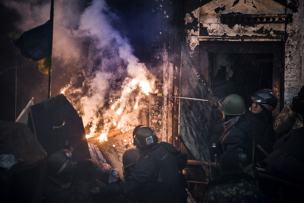Description of . Anti-government demonstrators clash with riot police in central Kiev on February 18, 2014.    AFP PHOTO / SANDRO  MADDALENA/AFP/Getty Images