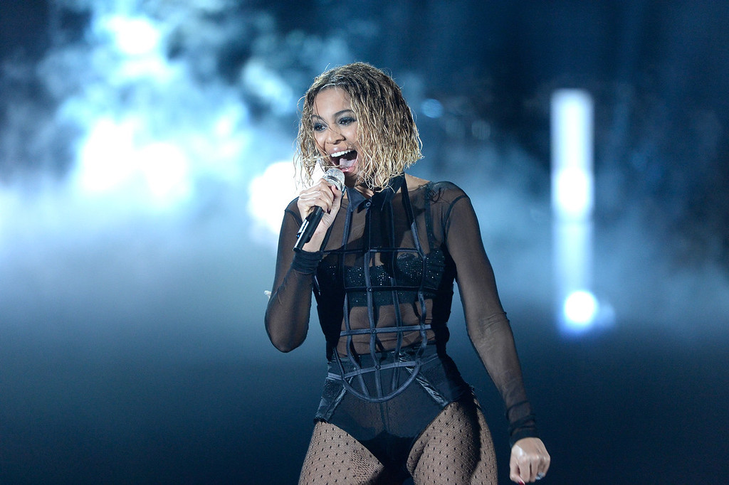 Description of . Singer Beyonce performs onstage during the 56th GRAMMY Awards at Staples Center on January 26, 2014 in Los Angeles, California.  (Photo by Kevork Djansezian/Getty Images)