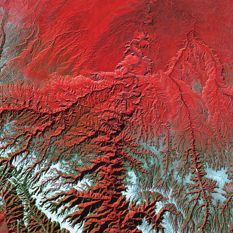 Description of . Desolation Canyon, United States Nearly as deep as the Grand Canyon, Desolation Canyon is one of the largest unprotected wilderness areas in the American West. In this Landsat 7 image from 2000, the Green River in Utah flows south across the Tavaputs Plateau (top) before entering the canyon (center). Desolation Canyon has a rich history. Geologist and explorer John Wesley Powell named the canyon. During two river expeditions in 1869 and 1871, Powell�s team mapped the Green River for the first time before heading down the Colorado River to the Grand Canyon. People of the Fremont culture inhabited the canyon and the plateau from about 200 to 1300 C.E. The present-day Ute Tribe owns the land along the east side of the river. Fremont and Ute pictographs and petroglyphs are abundant in Desolation and its numerous tributary canyons. The U.S. declared Desolation Canyon a National Historic Landmark in 1968.   NASA
