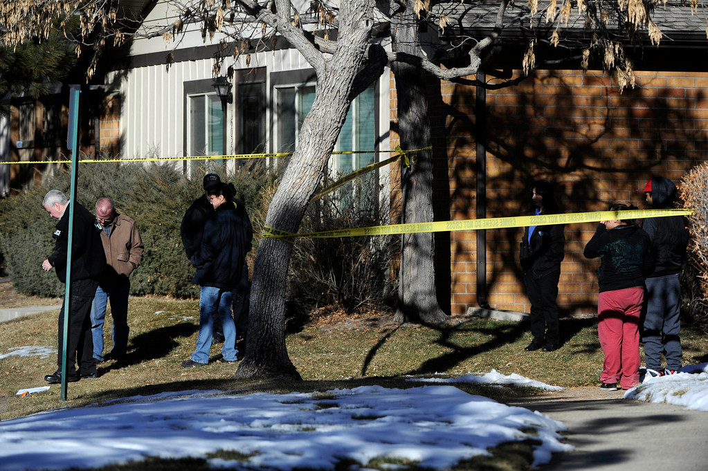 Description of . Aurora Police investigators, left, start their work at a crime scene at 16005 Ithaca Place in Aurora Saturday afternoon. The bodies of four people, including a gunman are dead at the scene following a standoff situation early Saturday morning. The Denver Post/ Andy Cross