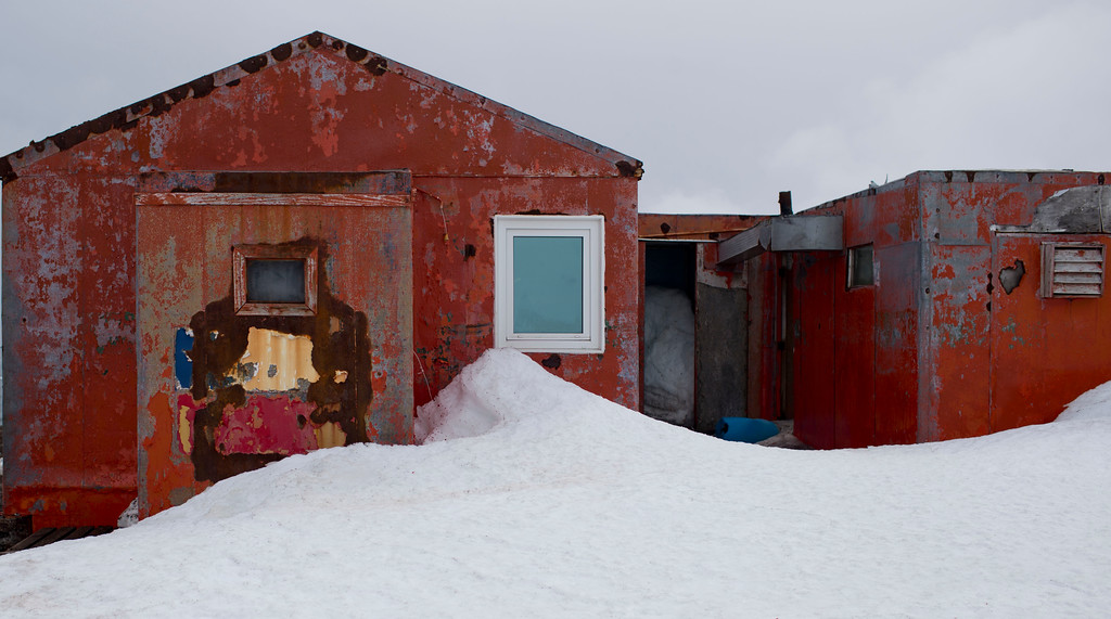 Description of . In this Jan. 24, 2015 photo, snow surrounds buildings used by Chile's scientists on Robert Island, part of the South Shetland Islands archipelago in Antarctica. Temperatures can range from above zero in the South Shetlands and Antarctic Peninsula to the unbearable frozen lands near the South Pole. (AP Photo/Natacha Pisarenko)