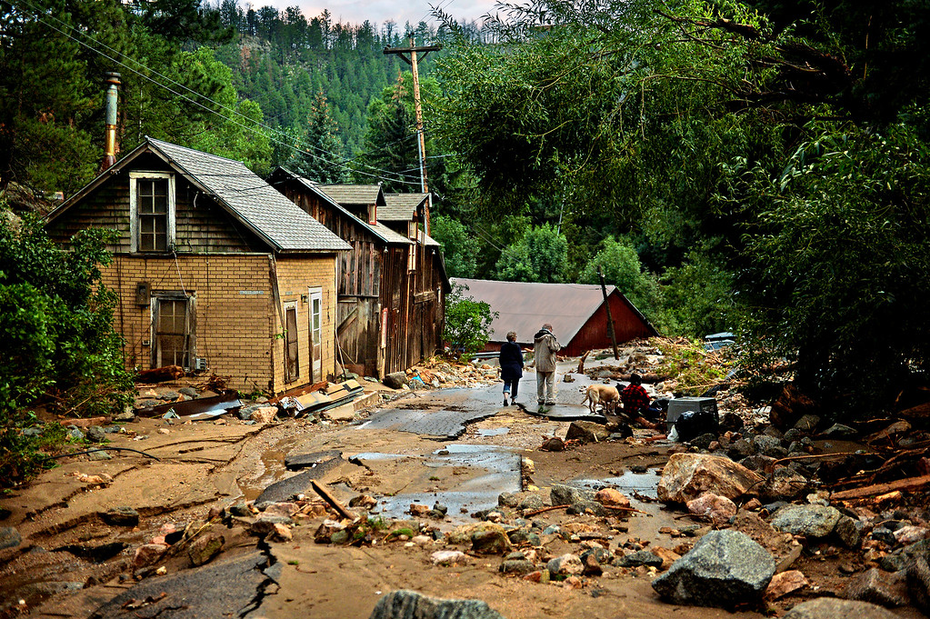 Description of . Four Mile Creek, which usually dries up by the end of summer, roared in a pitch of churning water, tumbling boulders, cracking trees and destroying all roads through Salina, Colo. Boulder County Emergency Management said more than 1,500 people were evacuated with assistance from the area. Although most of the evacuees were physically fine, they had gone days without electricity, phone service and information.