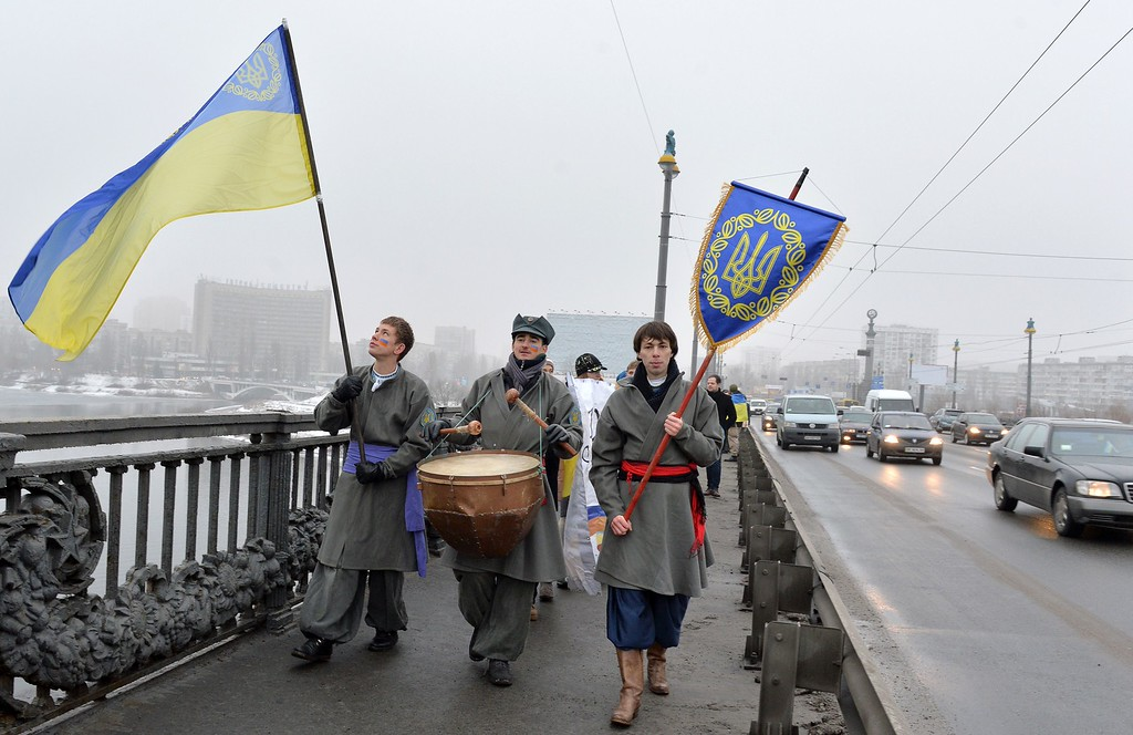 Description of . A man waves a Ukrainian flag as people form a human chain on the bridge across the Dnieper river in Kiev to mark the Day of Unityof Ukraine in Kiev on January 22, 2015. Ukraine marks on January 22, 2015 the 96th anniversary of the unification of eastern and western Ukraine in 1919. GENYA SAVILOV/AFP/Getty Images
