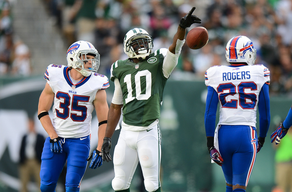Description of . Wide receiver Santonio Holmes #10 of the New York Jets celebrates after a 1st down in the 1st half of the Jets game against the Buffalo Bills at MetLife Stadium on September 22, 2013 in East Rutherford, New Jersey. (Photo by Ron Antonelli/Getty Images)