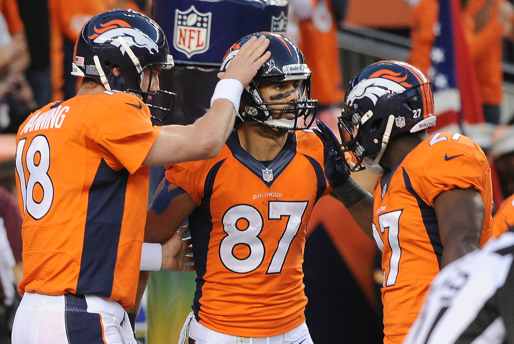 Description of . DENVER, CO - SEPTEMBER 23: Denver Broncos wide receiver Eric Decker is congratulated by Peyton Manning and Knowshon Moreno after a touchdown catch in the first quarter. The Denver Broncos took on the Oakland Raiders at Sports Authority Field at Mile High in Denver on September 23, 2013. (Photo by Steve Nehf/The Denver Post)