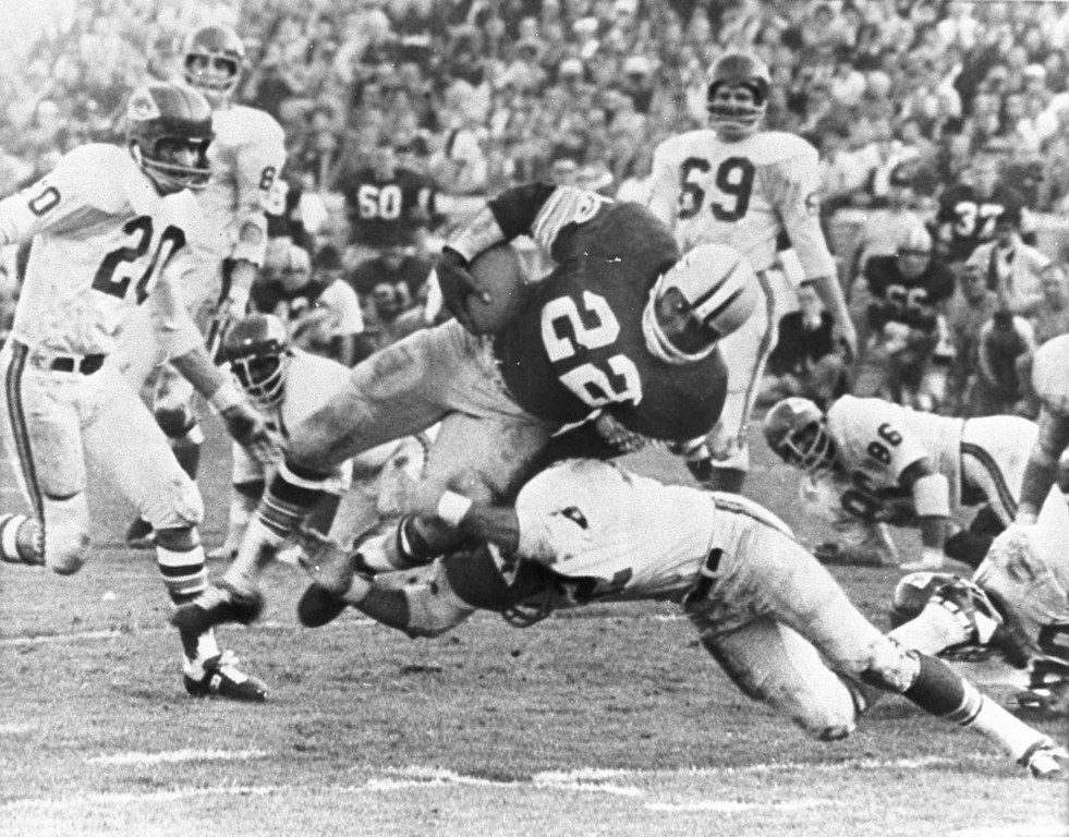 Description of . The Packers\' Klijah Pitts (22) goes over right tackle to the Chiefs\' five-yard line, a six-yard gain, before being brought down by Kansas City\'s Johnny Robinson in the fourth quarter of the Super Bowl game in Los Angeles Jan. 15, 1967.  Three plays later Pitts went over for the touchdown as the Packers beat the Chiefs 35 to 10.  Others include Bobby Hunt (20) and Sherrill Headrick (69).  (AP Photo)
