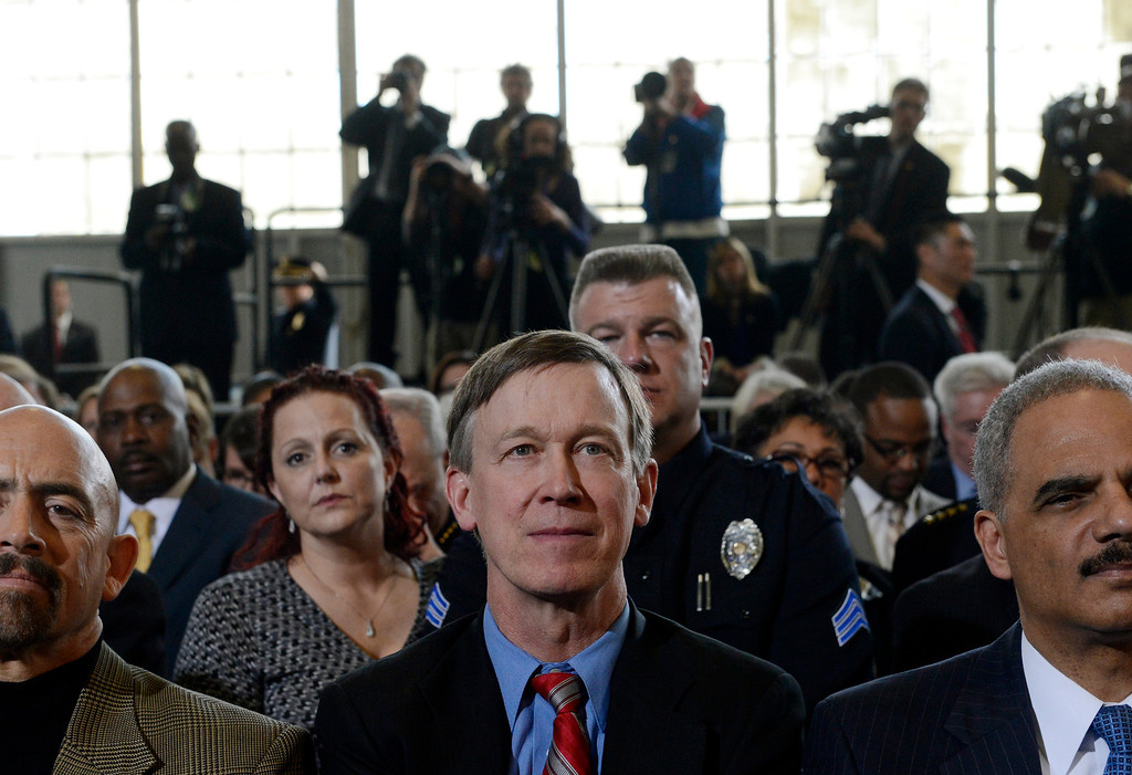 Description of . DENVER, CO. - APRIL 03: Gov. John Hickenlooper listens to President Barack Obama during a forum at the Denver Police Academy in Denver, CO April 03, 2013. In his first trip to Colorado since his re-election, President Obama urged Congress to act more like the state's Democratic-controlled legislature and quickly pass stronger gun-control laws. During the meeting with law enforcement officials and community leaders, Obama praised Hickenlooper and lawmakers for passing some of the nation's strongest gun-control measures after the shootings in Aurora and at a Connecticut elementary school. (Photo By Craig F. Walker/The Denver Post)