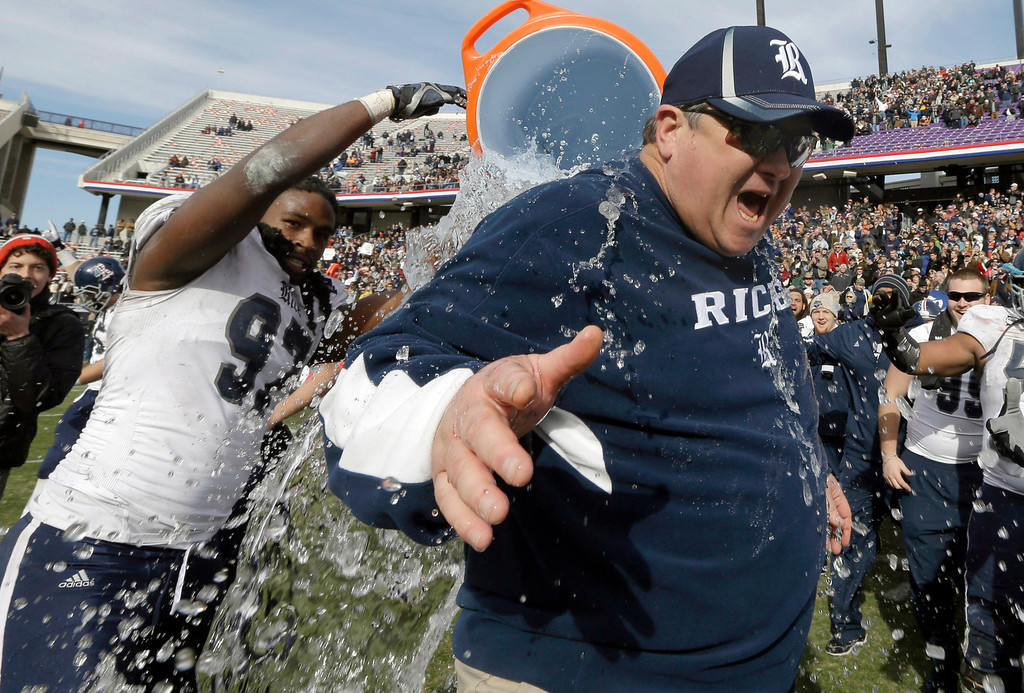 Description of . Rice head coach Troy Calhoun is drenched in water by defensive end Jared Williams (97) after the end of the Armed Forces Bowl NCAA college football game against Air Force, Saturday, Dec. 29, 2012, in Fort Worth, Texas. Rice won 33-14. (AP Photo/LM Otero)