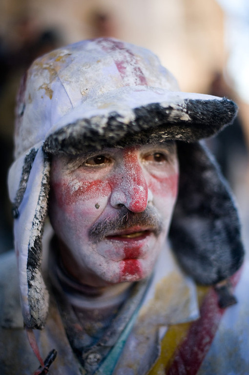 Description of . A Reveller poses after taking part in the battle of \'Enfarinats\', a flour fight in celebration of the Els Enfarinats festival on December 28, 2012 in Ibi, Spain. Citizens of Ibi annually celebrate the festival with a battle using flour, eggs and firecrackers. The battle takes place between two groups, a group of married men called \'Els Enfarinats\' which take the control of the village for one day pronouncing a whole of ridiculous laws and fining the citizens that infringe them and a group called \'La Oposicio\' which try to restore order. At the end of the day the money collected from the fines is donated to charitable causes in the village. The festival has been celebrated since 1981 after the town of Ibi recovered the tradition but the origins remain unknown.   (Photo by David Ramos/Getty Images)