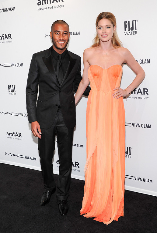 Description of . Model Doutzen Kroes, right, and husband Sunnery James attend amfAR's New York gala at Cipriani Wall Street on Wednesday, Feb. 6, 2013 in New York. (Photo by Evan Agostini/Invision/AP)