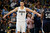 Denver Nuggets forward Danilo Gallinari, of Italy, reacts after hitting a three-point basket as Memphis Grizzlies forward Zach Randolph looks on late in the fourth quarter of the Nuggets' 87-80 victory in an NBA basketball game in Denver on Friday, March 15, 2013. (AP Photo/David Zalubowski)