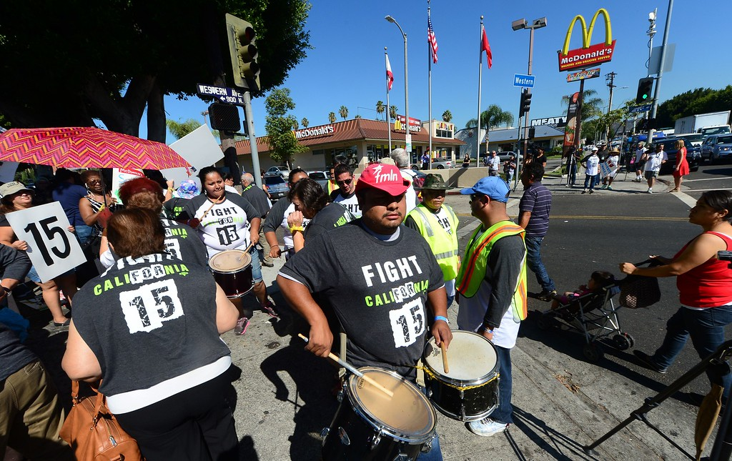 Description of . Fast food workers and their supporters take part in a nationwide strike outside a McDonald's fastfood outlet demanding higher wages and the right to form a union on August 29, 2013 in Los Angeles, California, where the fast food restaurant workers were calling for a $15.00 per hour wage.  AFP PHOTO/Frederic J. BROWN/AFP/Getty Images