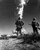 Two soldiers look at an atomic cloud during a nuclear bomb testing in Nevada in this 1952 file photo. Newly declassified Pentagon records show that troop exercises during nuclear bomb tests in the 1950s were designed to pursued soldiers their fear of radiation was irrational and to give them