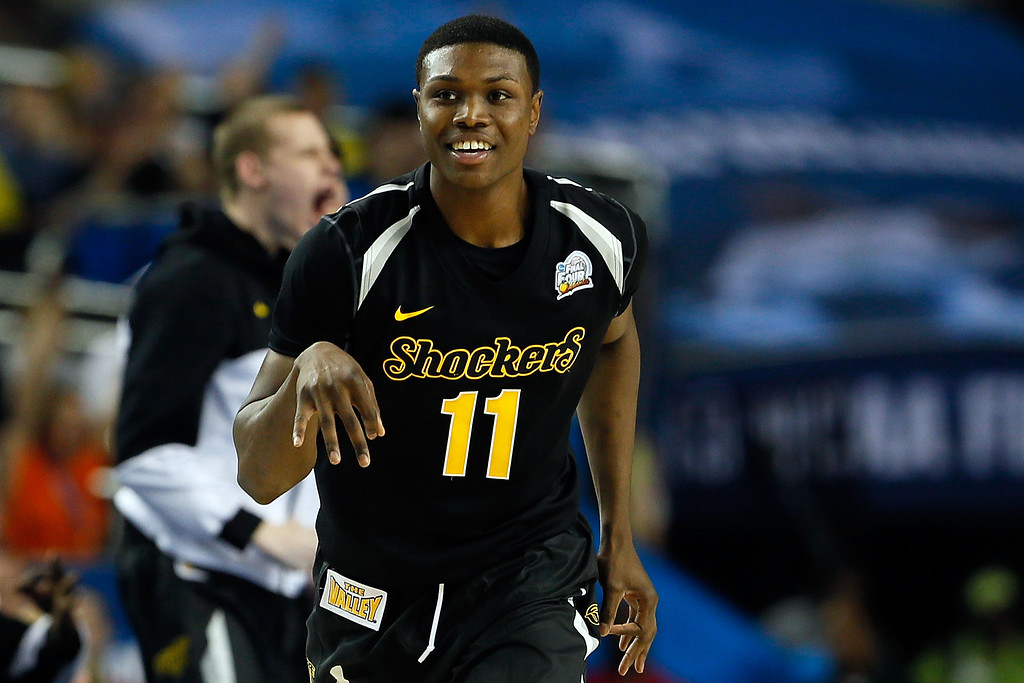 Description of . ATLANTA, GA - APRIL 06:  Cleanthony Early #11 of the Wichita State Shockers reacts after he made a 3-point basket in the second half against the Louisville Cardinals during the 2013 NCAA Men's Final Four Semifinal at the Georgia Dome on April 6, 2013 in Atlanta, Georgia.  (Photo by Kevin C. Cox/Getty Images)