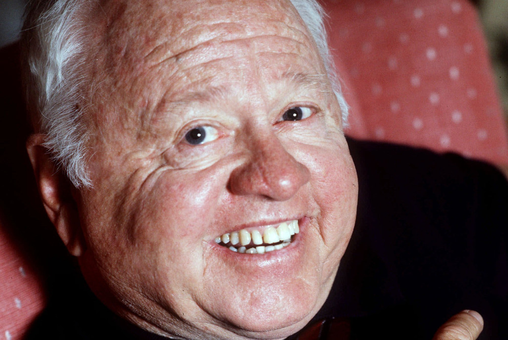 Description of . Entertainer Mickey Rooney is shown in this May 1987 file photo. Rooney, a Hollywood legend whose career spanned more than 80 years, has died. He was 93. Los Angeles Police Commander Andrew Smith said that Rooney was with his family when he died Sunday, April 6, 2014, at his North Hollywood home. (AP Photo/File)