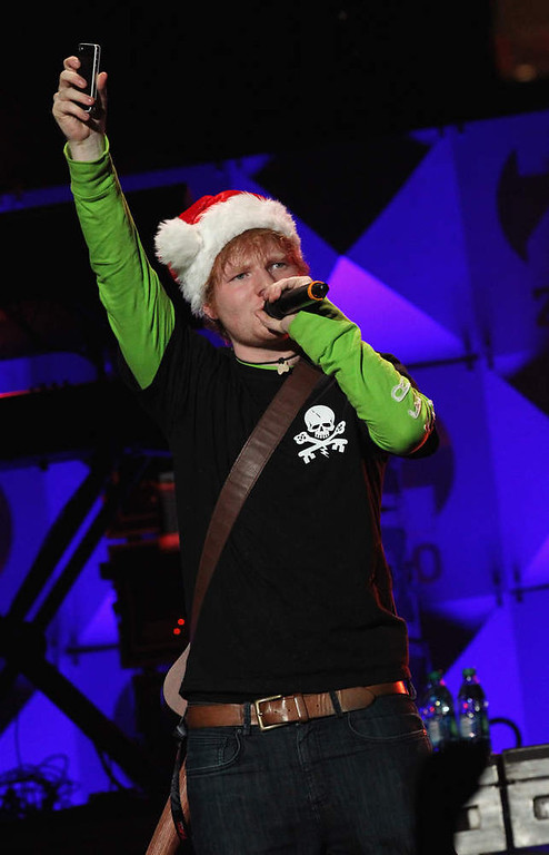Description of . Ed Sheeran performs onstage during Z100's Jingle Ball 2012, presented by Aeropostale, at Madison Square Garden on December 7, 2012 in New York City.  (Photo by Kevin Kane/Getty Images for Jingle Ball 2012)