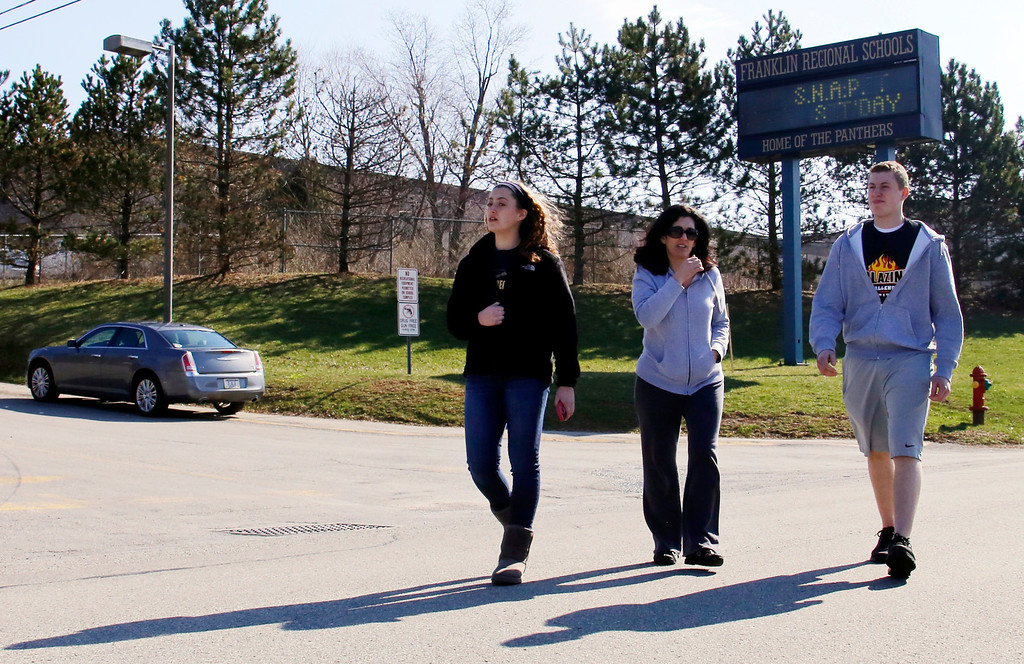 Description of . Students are escorted as they leave the campus of the Franklin Regional School District after more then a dozen students were stabbed by a knife wielding suspect at nearby Franklin Regional High School on Wednesday, April 9, 2014, in Murrysville, Pa., near Pittsburgh. The suspect, a male student, was taken into custody and is being questioned. (AP Photo/Gene J. Puskar)