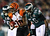 Brandon Tate #19 of the Cincinnati Bengals carries the ball as Akeem Jordan #56 of the Philadelphia Eagles defends on December 13, 2012 at Lincoln Financial Field in Philadelphia, Pennsylvania.  (Photo by Elsa/Getty Images)