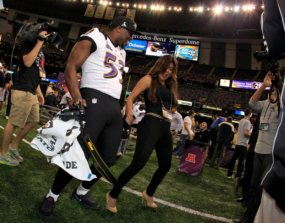 Description of . Baltimore Ravens linebacker Adrian Hamilton dances with Telemundo reporter Mireya Grisales during Media Day for the NFL's Super Bowl XLVII in New Orleans, Louisiana January 29, 2013. The San Francisco 49ers will meet the Ravens in the game on February 3. REUTERS/Sean Gardner