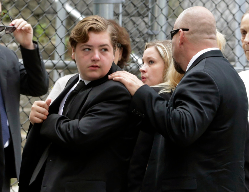 Description of . Michael Gandolfini, left, son of James Gandolfini, arrives for the funeral service of his father, star of