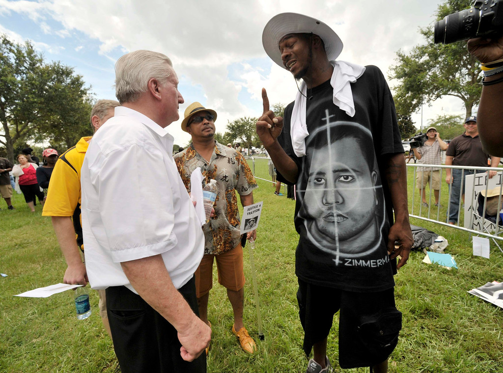 Description of . Casey David Kole (L), a supporter of George Zimmerman argues with Ike Thomas of Sanford, FL outside Seminole County Court where George Zimmerman's second-degree murder trial is being deliberated by jurors in Sanford, Florida, July 13, 2013.  REUTERS/Steve Nesius