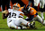 Denver Broncos strong safety Mike Adams (20) tackles Cleveland Browns quarterback Colt McCoy (12) during the fourth quarter. The Denver Broncos vs Cleveland Browns at Sports Authority Field Sunday December 23, 2012. Tim Rasmussen, The Denver Post