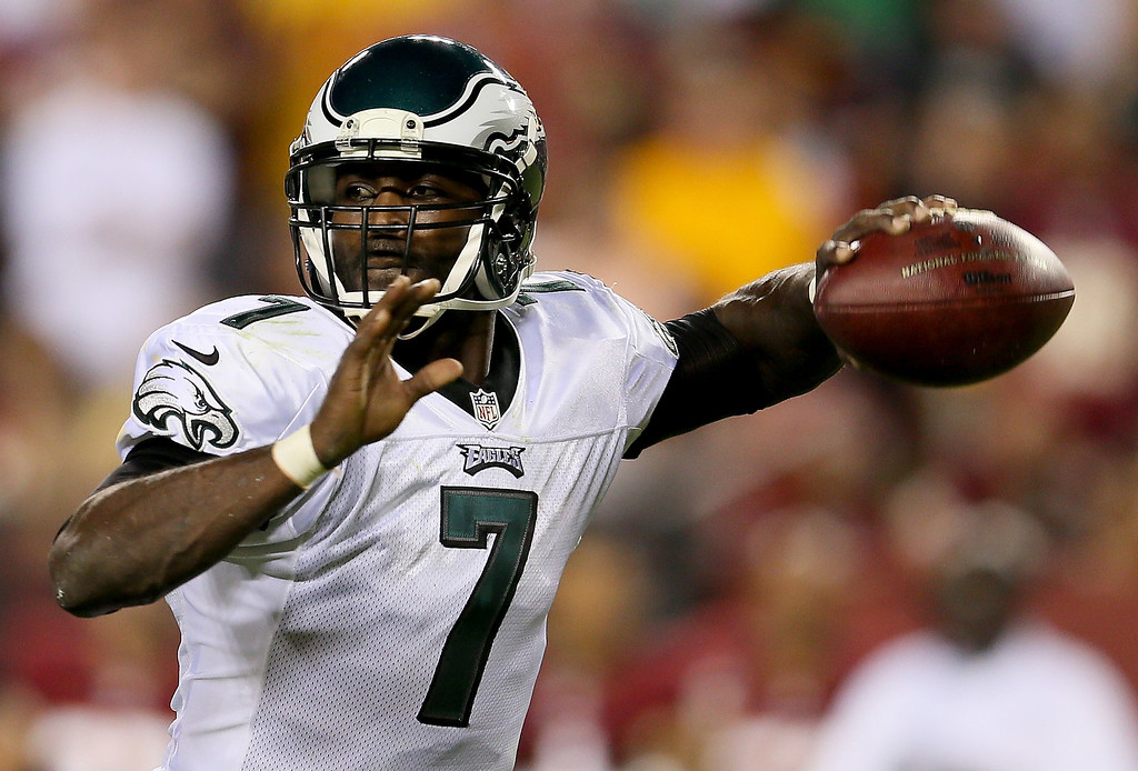 Description of . Quarterback Michael Vick #7 of the Philadelphia Eagles throws the ball in the second quarter against the Washington Redskins at FedExField on September 9, 2013 in Landover, Maryland.  (Photo by Rob Carr/Getty Images)